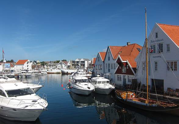 View over white houses and boats in Skudeneshavn, Karmøy, Fjord Norway