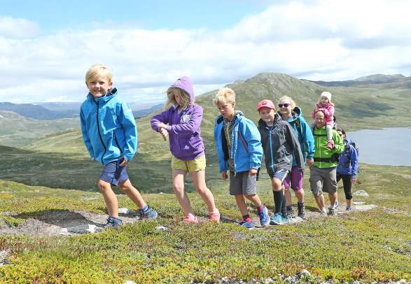 A group of adults and children hiking in the Hemsedal mountains in Eastern Norway