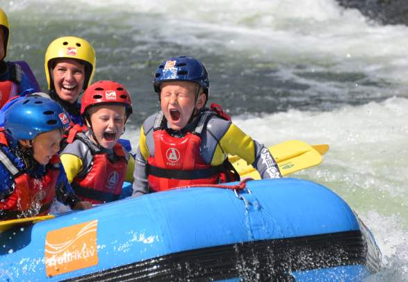 A happy family rafting in Setesdal, Southern Norway