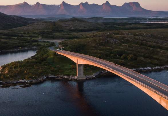 A bridge connecting Herøy to another island in Helegeland, Northern Norway. In the background, the mountain range The seven sisters.
