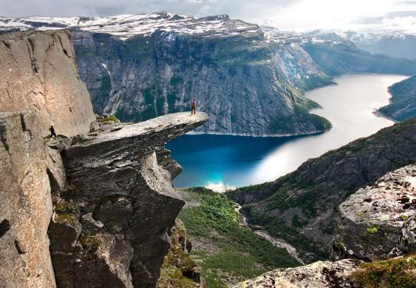 A person on the mountain plateau Trolltunga above Lake Ringedalsvatnet in the Hardangerfjord region, Fjord Norway