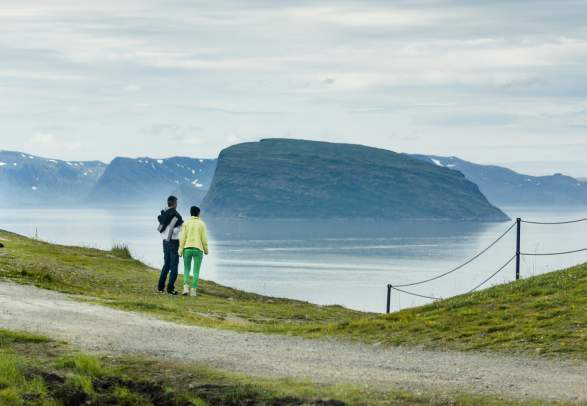 People walking along the sea in Hammerfest