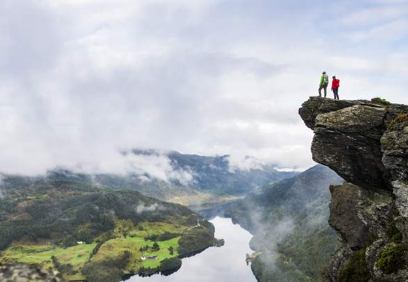 Two people are admiring the view from the top of Himakånå in Haugalandet in Fjord Norway.