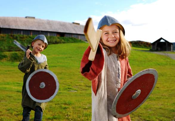 Two children wearing viking costumes at Stiklestad National Culture Centre