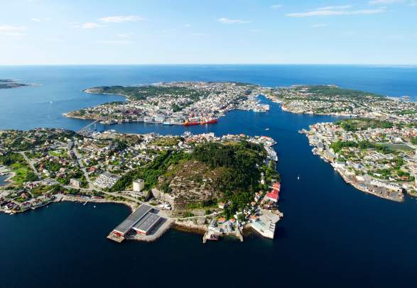 Overview of the city Kristiansund in Fjord Norway from above in the sunshine.