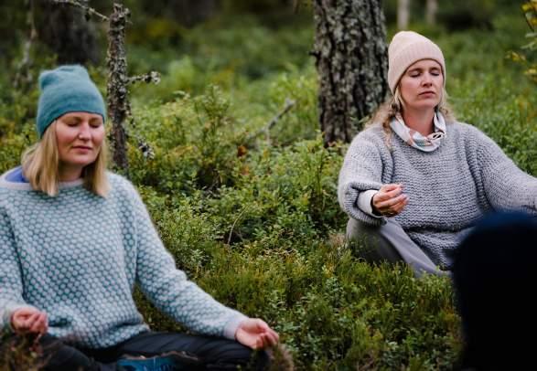 Two women meditation in the Finnskogen forest in Hedmark county