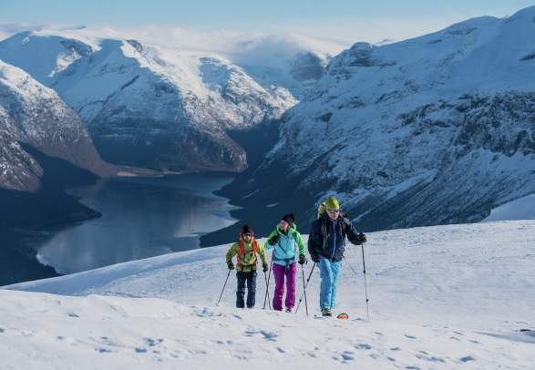 Three people ski touring at Mount Hoven in Loen in Nordfjord, Fjord Norway