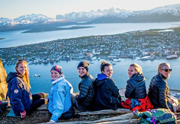 A group of young women enjoying the view of Tromsø city, Northern Norway