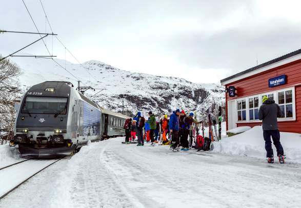 Ski tourers at the Vatnahalsen train station in Fjord Norway