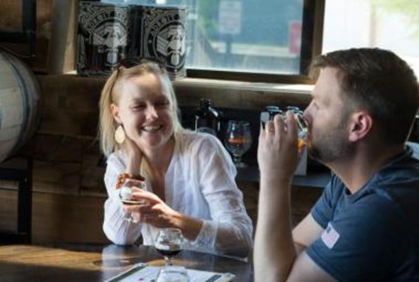 Couple enjoying a beer at Adroit Theory Brewing Company