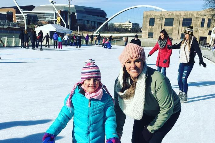 kid and mom ice skating at brenton skating plaza