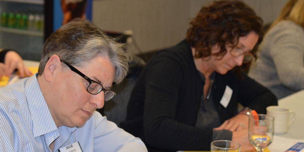 Two women diligently taking notes during the March 2018 Industry Insider Training event