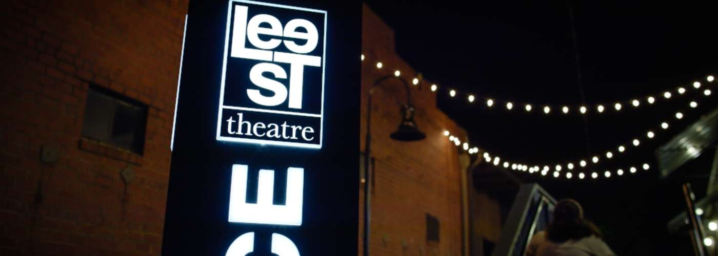 Lee St. Theater Sign lit up at night