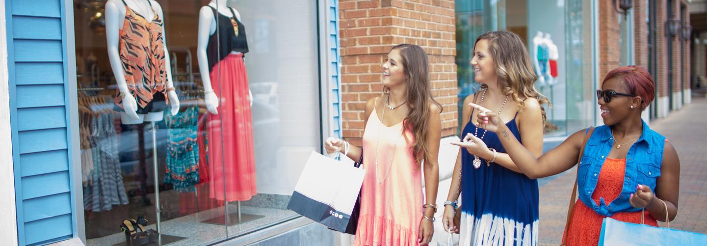 Three women window-shopping Baton Rouge boutiques