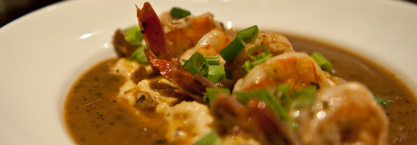 Close-up photo of beautiful shrimp and grits dish
