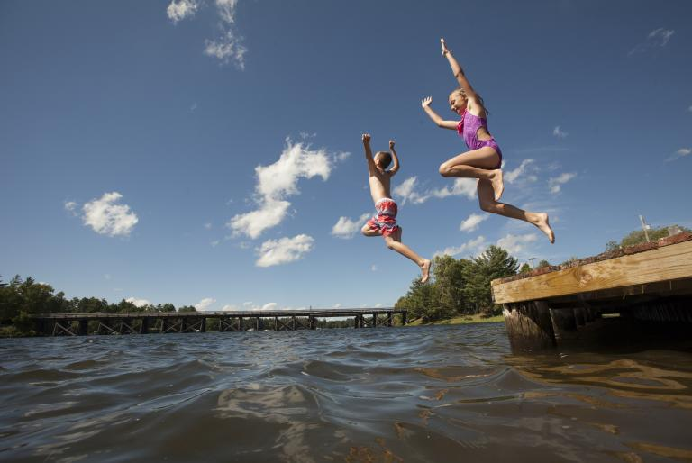 kids jumping into water