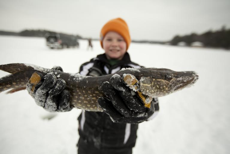 Kid ice fishing in Minocqua, WI