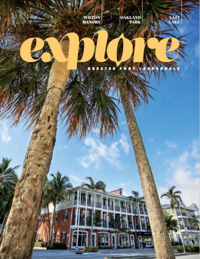 Cover of Explore GFL magazine showing an apartment building in Wilton Manors framed between two palm trees