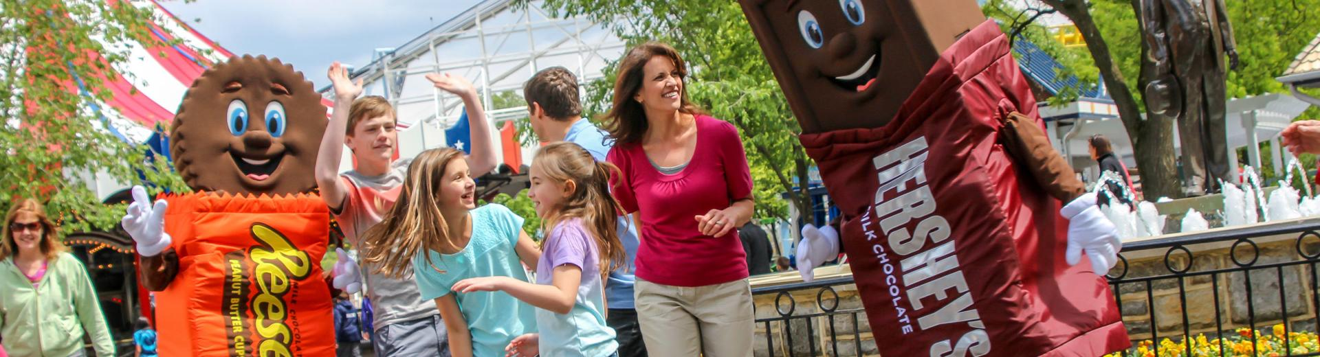Family at Hershey amusement park with Hershey chocolate mascot