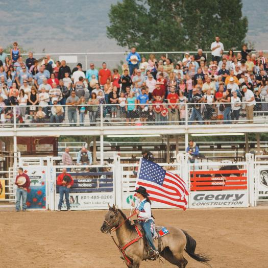 Oakley Rodeo Queen Waving the American Flag
