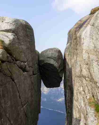 The Kjeragbolten boulder wedged in a mountain crevasse above the Lysefjord in Norway