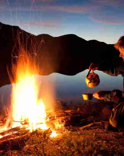 A man making coffee on a campfire in Kautokeino, Norway