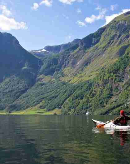A person paddling in the Nærøyfjord in Fjord Norway