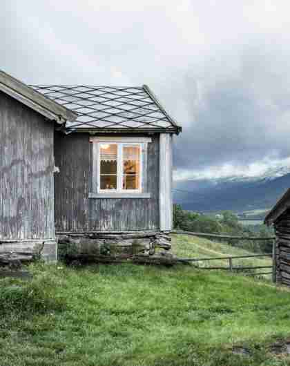 The grey houses of the farm Budsjord in the Gudbrandsdalen valley, Norway