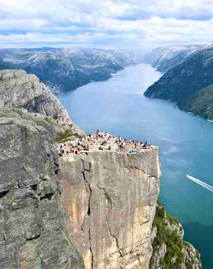 People enjoying the view of the Lysefjord from Preikestolen (the Pulpit Rock) in Ryfylke, Fjord Norway