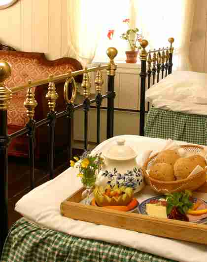 A breakfast bed on a bed in an old fashion manorial room
