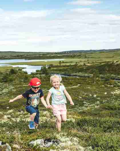 Two children are running in the mountains of Hallingdal, Eastern Norway