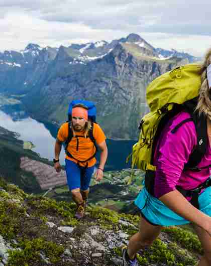 Two people hiking in the mountains near the Hjørundfjord, Fjord Norway
