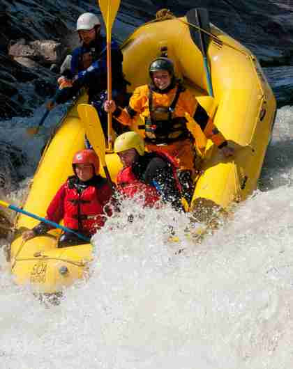 Four people rafting down the Sjoa river in Eastern Norway