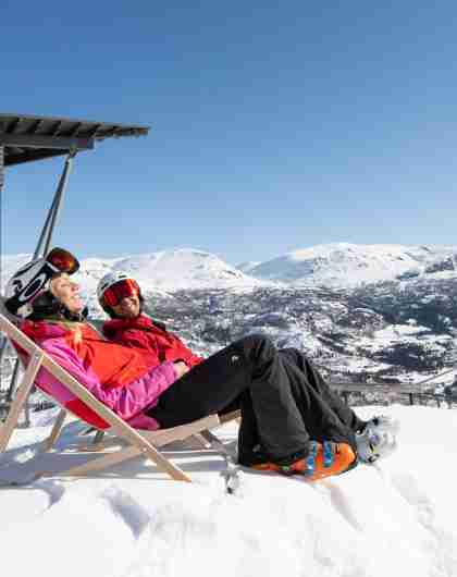 Couple relaxing in the warm easter sun after spring skiing in Hemsedal