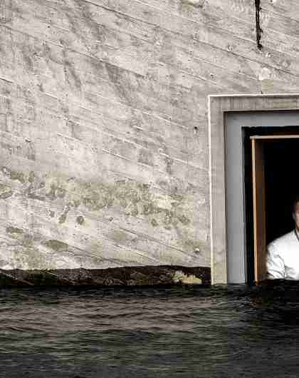 Chef Nicolai Ellitsgaard is looking out of the window at the partially submerged restaurant Under in Lindesnes, Southern Norway