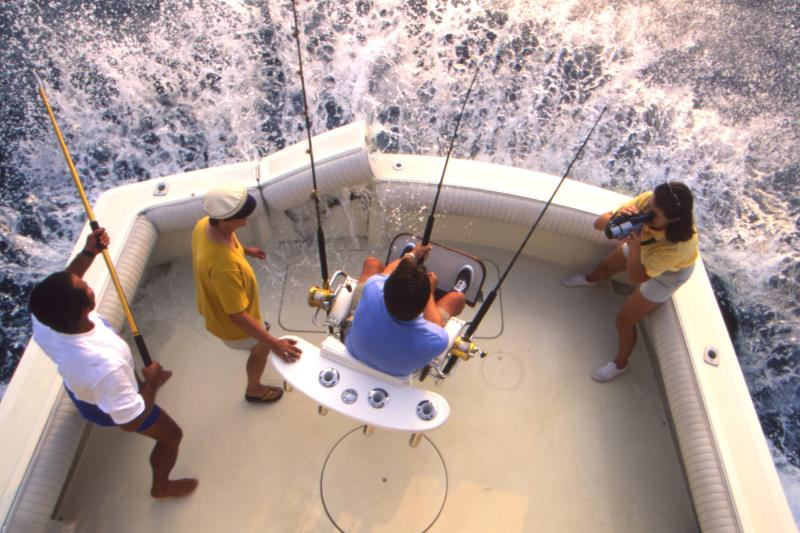 Women Filming 3 People Deep Sea Fishing Near Greater Fort Lauderdale