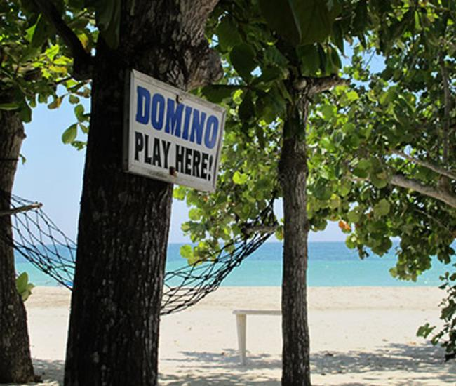 Domino Sign on Beach