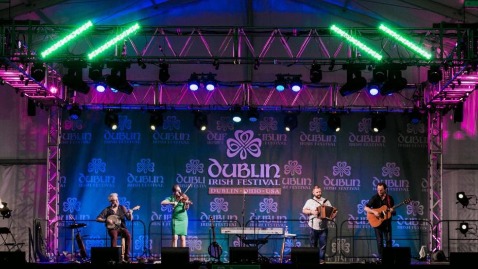 Irish band playing on the Celtic Rock stage at night at the Dublin Irish Festival.