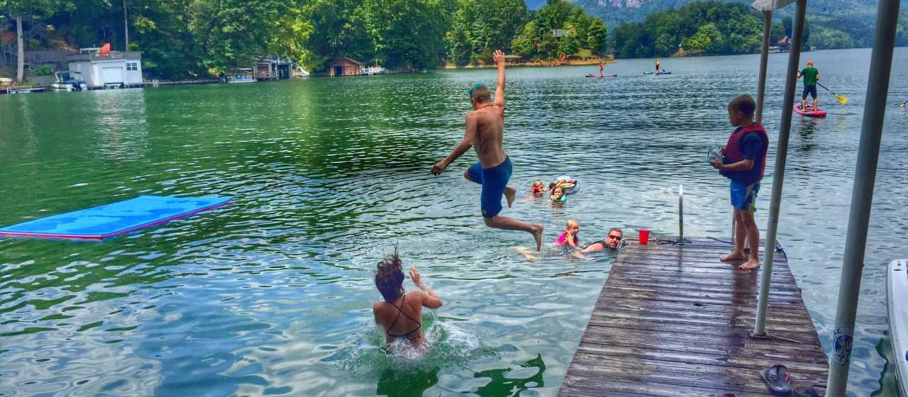A group of friends jumping into Lake Lure, NC}