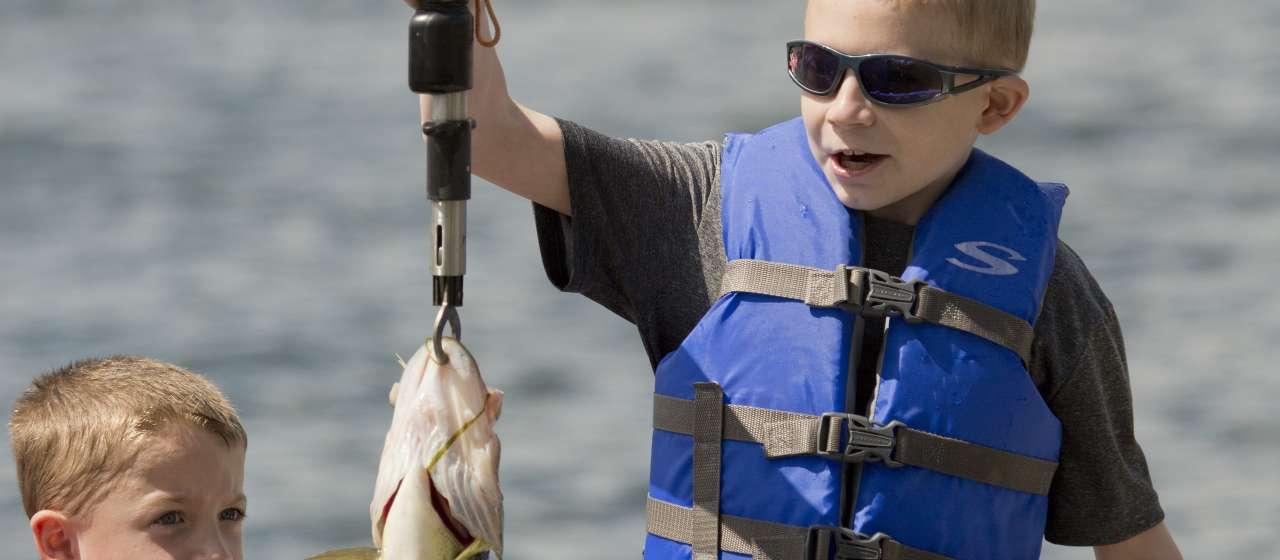 Boy catches fish