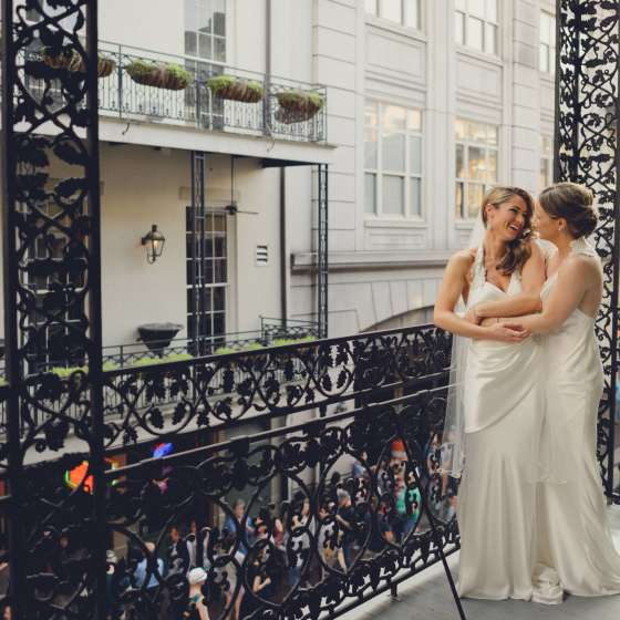 LGBT brides on balcony