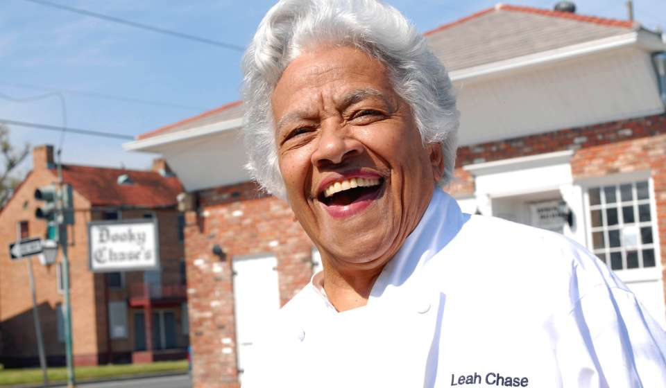 Leah Chase in front of Dooky Chase's Restaurant
