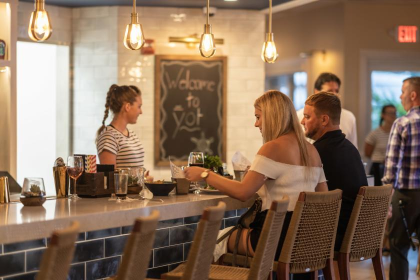 People Sitting At A Bar At YOT Bar & Kitchen In Fort Lauderdale