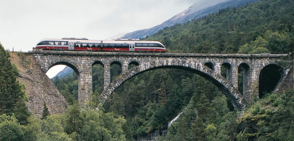 The Rauma Railway is one of the world's best train journeys. Train crossing Kylling bridge in Rauma, Fjord Norway.