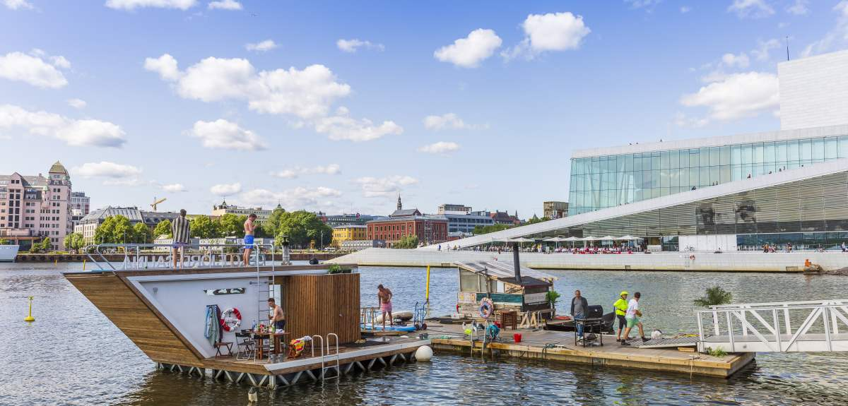 A floating sauna in front of Oslo opera house