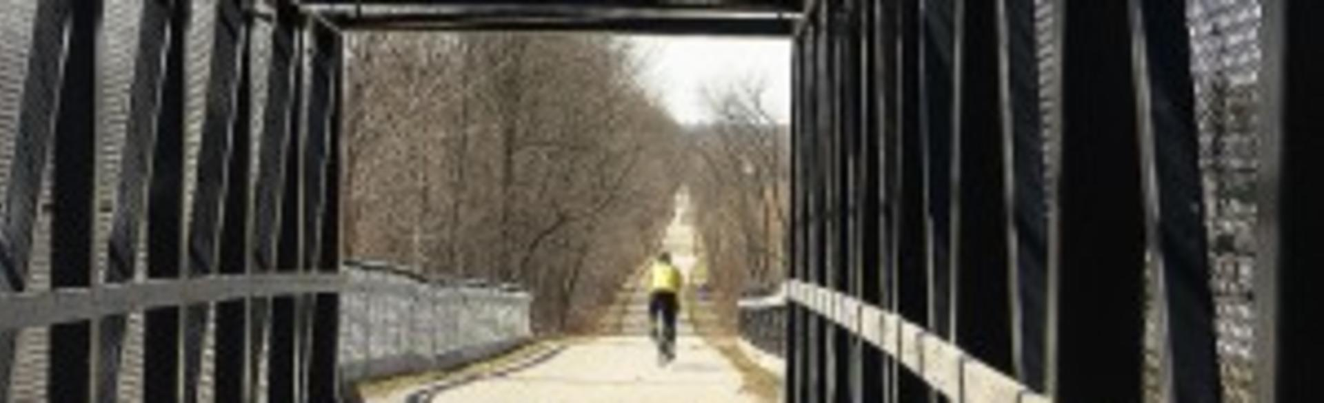 Bicyclist Crossing Bridge