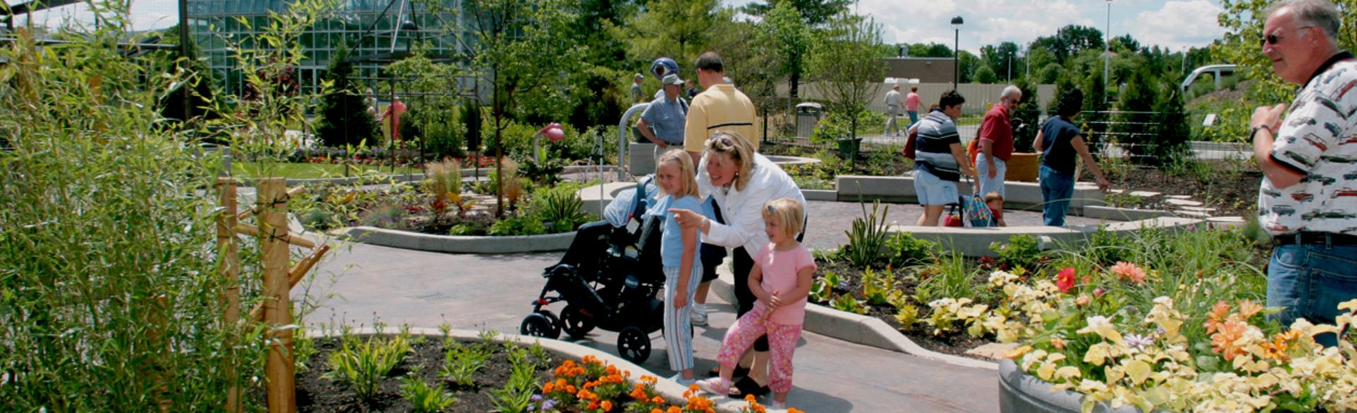 Children walking through the Lena Meijer Children's Garden