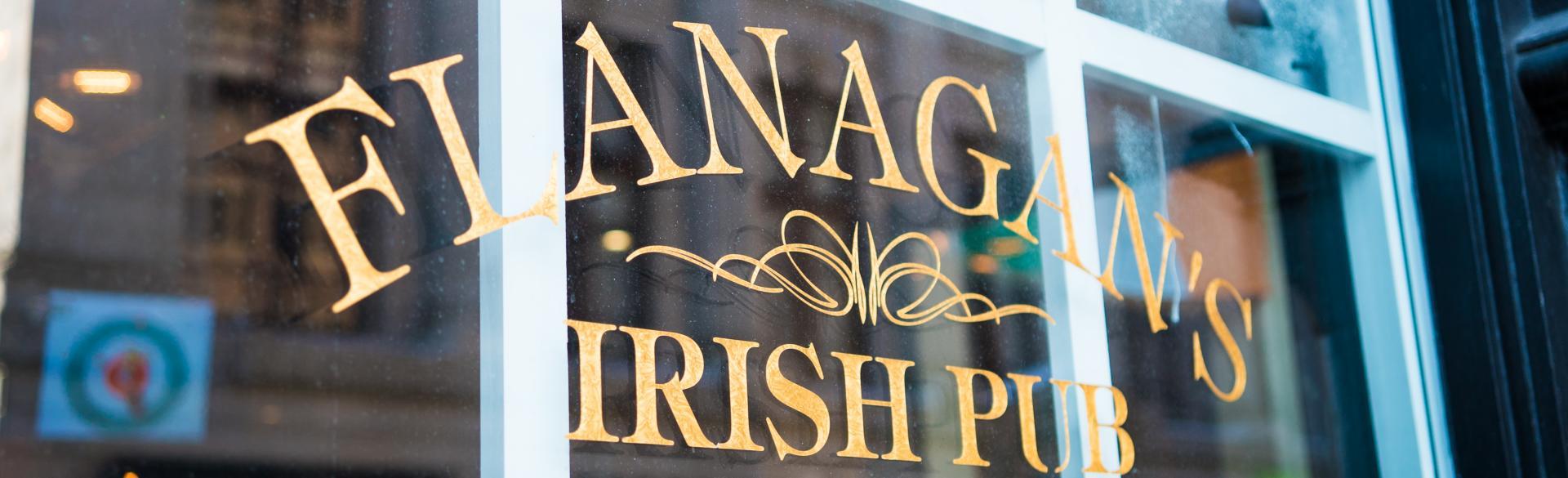 "Close up of window reading ""Flanagan's Irish Pub"""