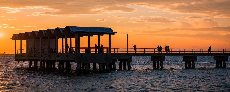 The sun sets behind the popular Jekyll Island Fishing Pier