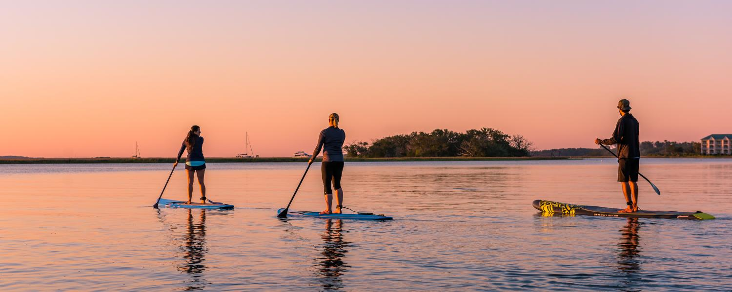 A group of friends enjoys the water on paddleboards in Golden Isles, Georgia
